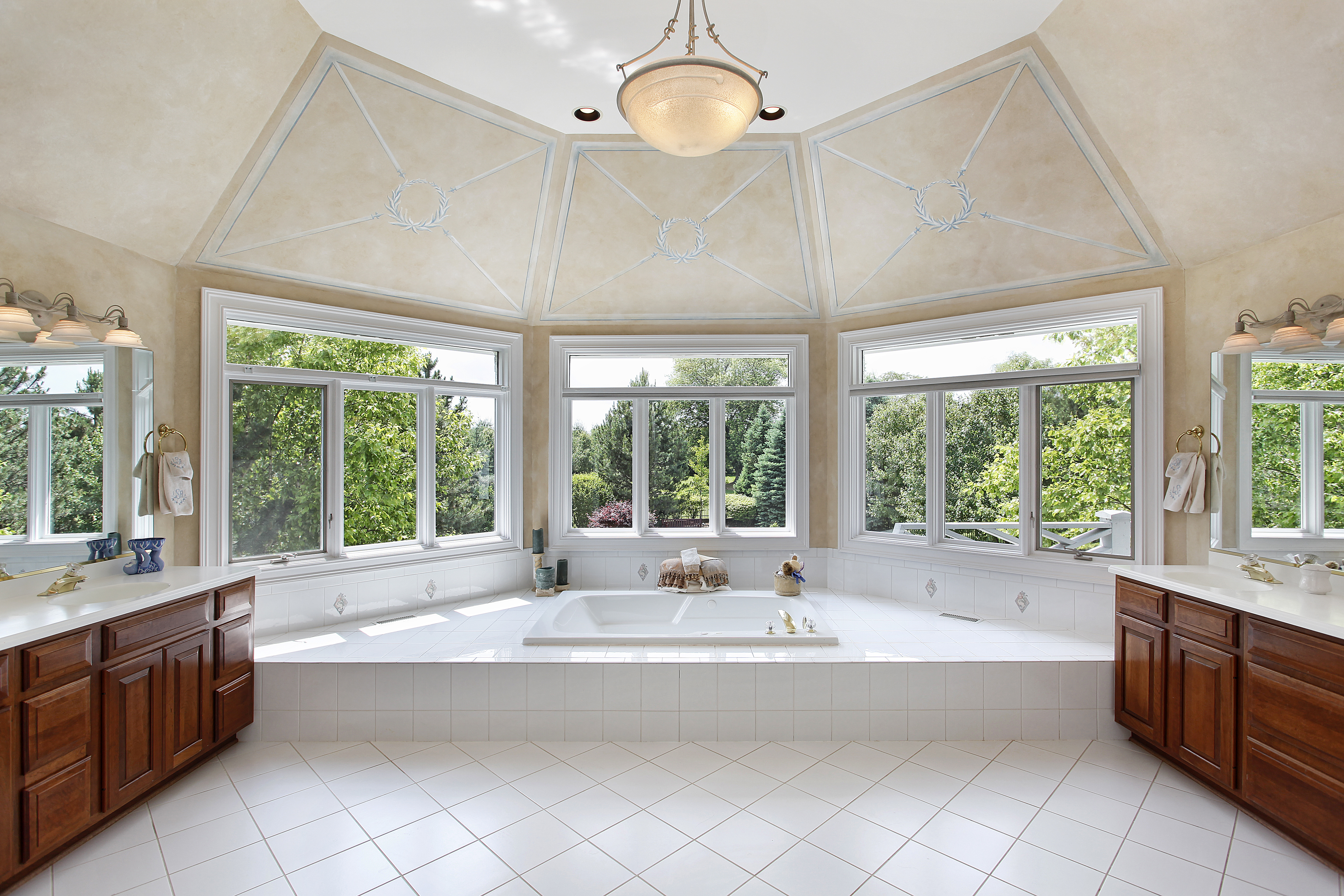 Master bath in luxury home with windowed tub area