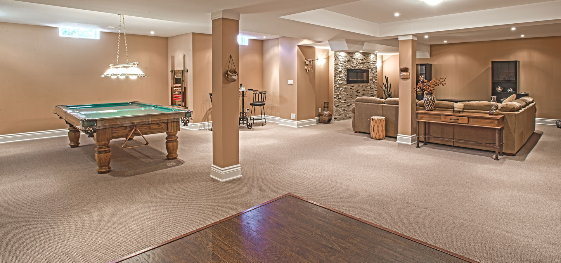 Large open basement with pool table