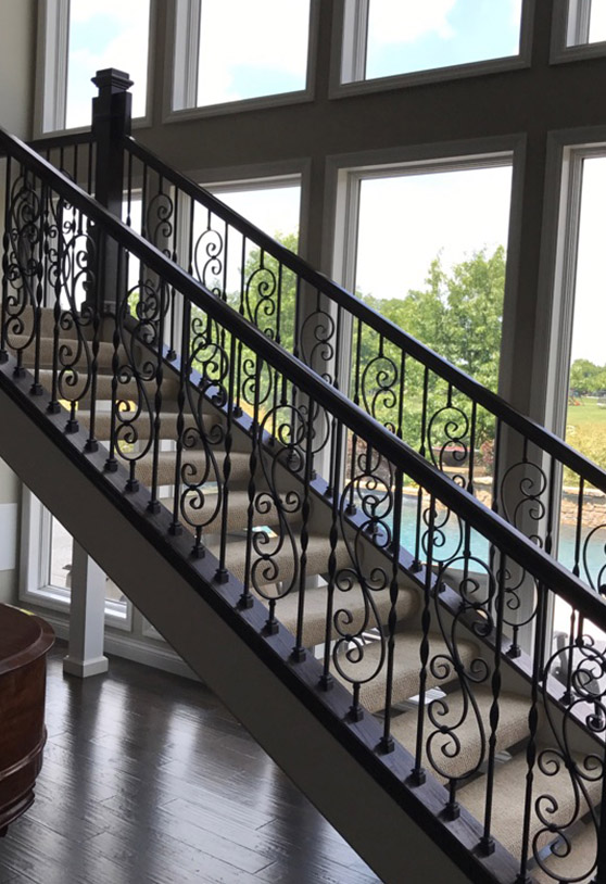 Iron staircase with styled balusters