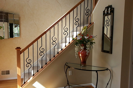 Split landing stair case with iron baluster scroll work