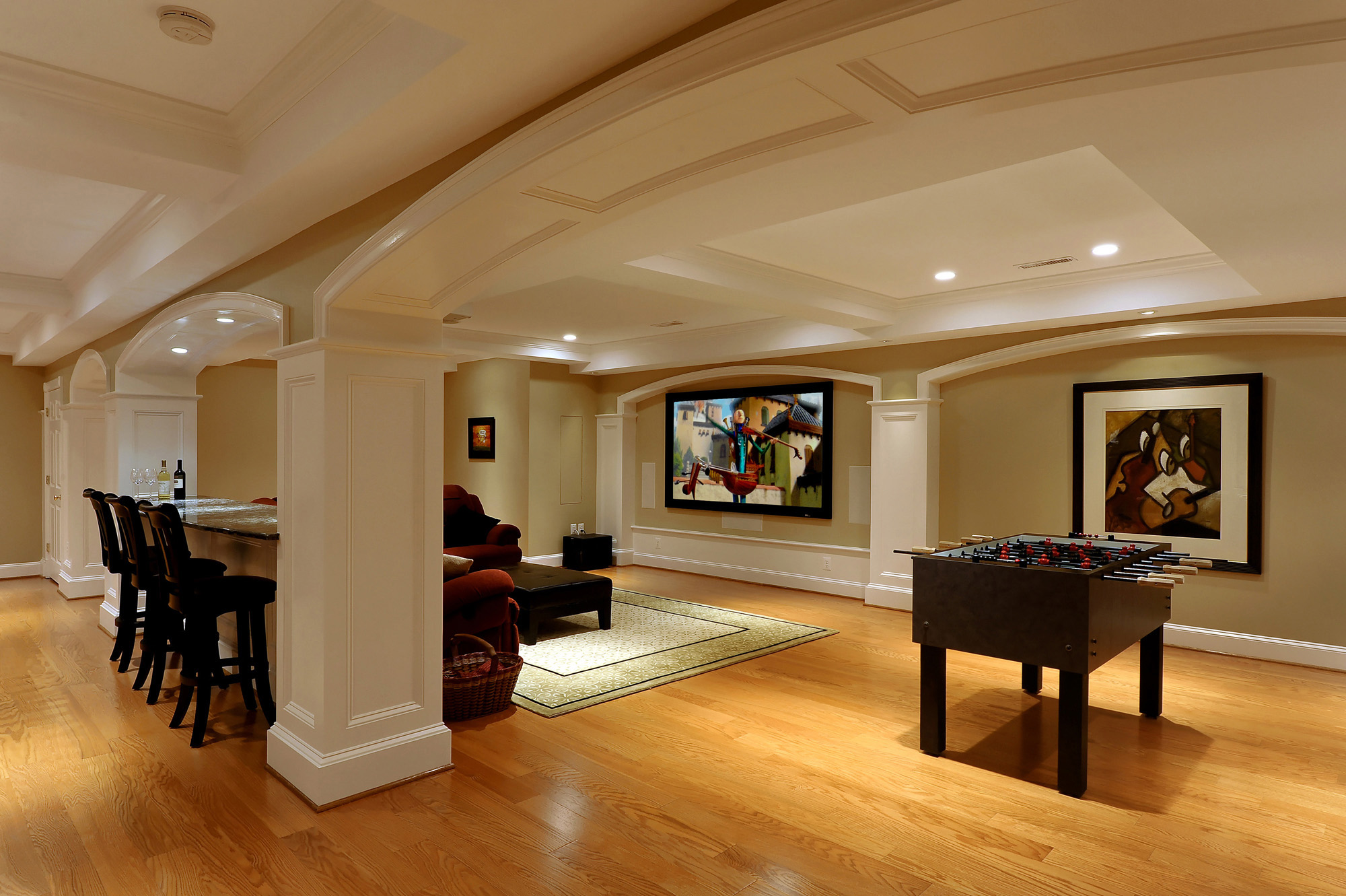 Large basement with detailed ceiling