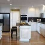 White cabinet kitchen with granite counter tops