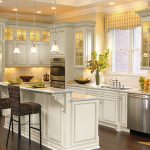 White wood kitchen with yellow accents