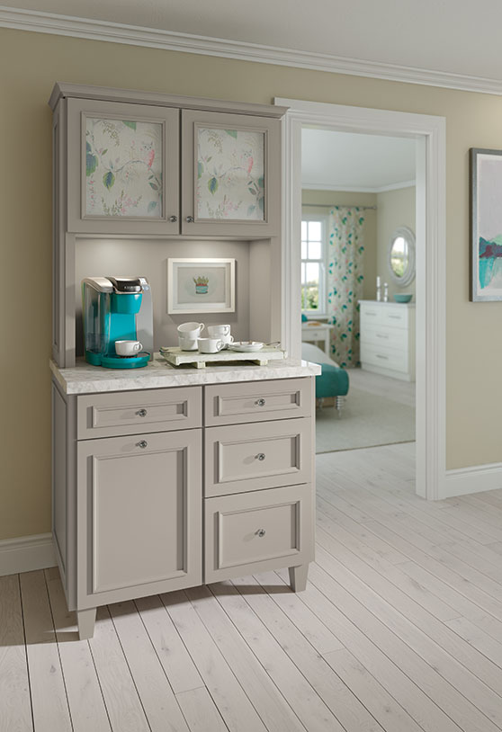 Pantry cabinets with teal coffeemaker