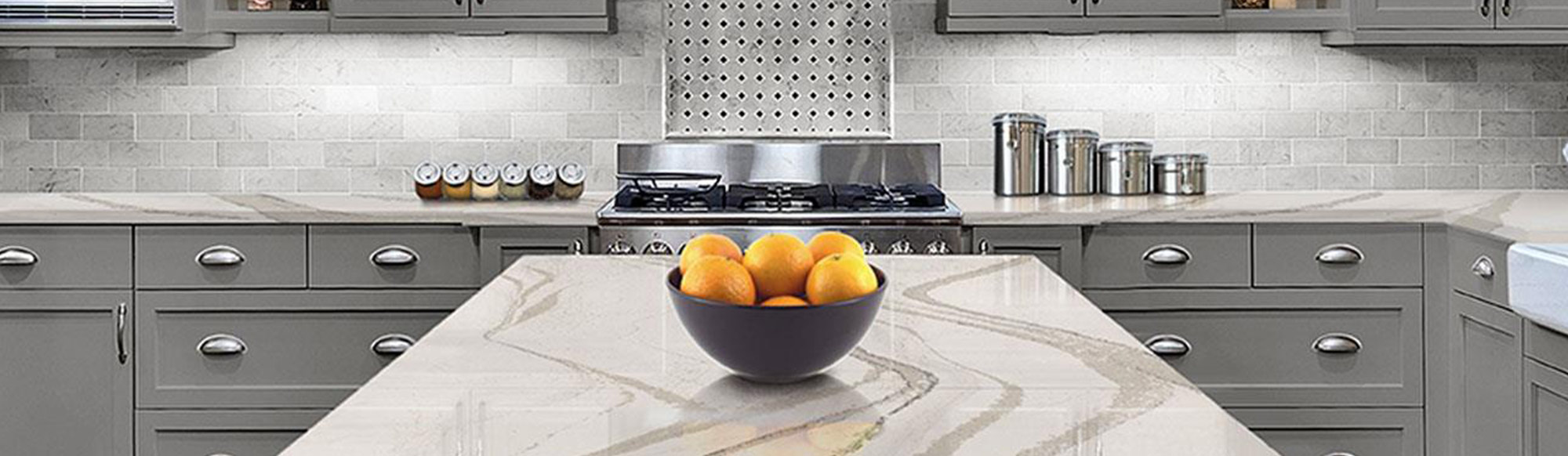Marble counter top with bowl of oranges